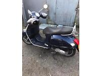 Vespa gts125 3 months mot cat d dew to a dent in the back panel