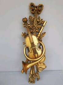 Musical ornament in gold finish violin and french horn