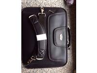 "15"" leather laptop case."