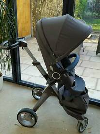 Stokke pushchair and carrycot with extra wheels and accessories- green