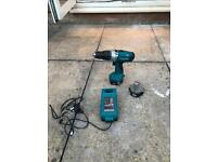 Makita drill with spare battery and charger.