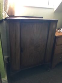 Antique walnut wood cabinet with shelves