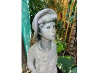 Weathered garden statue boy