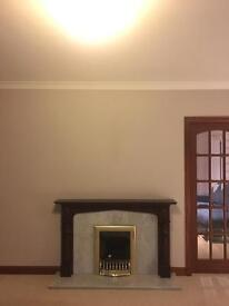Mahogany fireplace surround and marble