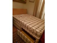 Double divan bed with large storage drawers