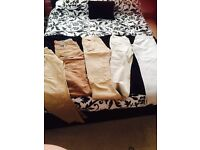 SELECTION OF 5 PAIRS OF MEN'S TROUSERS SIZE 32S + 34S