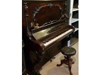 A circa 1850s piano cedar wood veneer with chair of approx same era