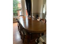 Mahogany extendable table and 10 chairs