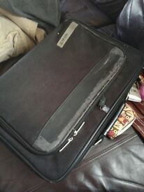 Laptop and bag and charger includes word documents downloaded