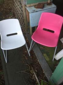 Two Ikea Snille plastic chairs in Pink and White - ideal for kids rooms.