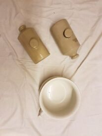 2 stone hot water bottles and a chamber pot