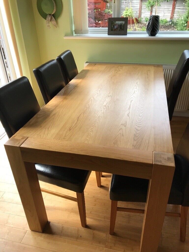 light oak dining table and 6 leather chairs  in