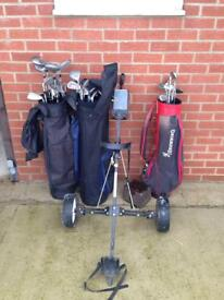 3 bags and golf clubs and 1 trolley