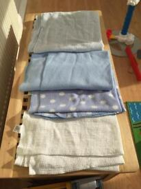 Four baby blankets