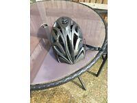 A grey diamond back bike helmet - for cycling and mountain biking