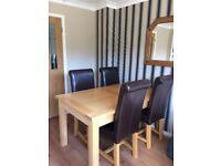 SOLID OAK EXTENDING DINING TABLE AND 4 CHAIRS