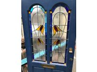Front door with stain glass windows