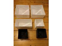 Six Ikea boxes