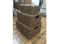 Three stacked wicker baskets for storage, bathroom or any room