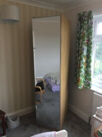 Single tall oak effect wardrobe with Mirror Door, hanging rail and shelf.