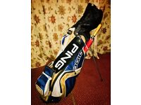 Set of Wilson deep red golf clubs, ohio bag and trolley