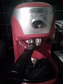 Red delongie coffee machine hardly used.coffee pods included with full instructions