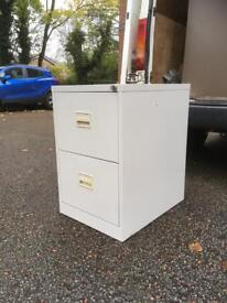 A two drawer filing cabinet.