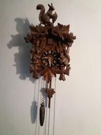 Genuine Black Forest hand carved wooden cuckoo clock