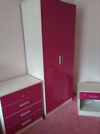 bright pink high gloss childs wardobe , and cupboards
