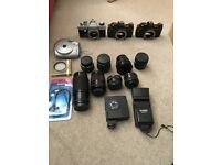 3 praktica camera bodies + 8 lenses, 2 flashes, filter etc. Job lot price!