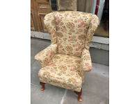 Parker Knoll Fireside Armchair , in a floral fabric.