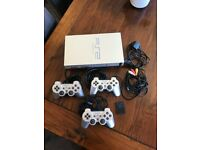 PS2 Silver, 3 controllers, 8mb memory card, verified as full working condition