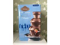 Chocolate fondue table fountain