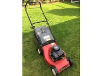 Champion push petrol lawnmower.