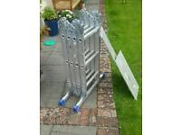 Folding ladder including trestles