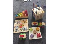 Bundle of wooden toys. Puzzles. Activity cube