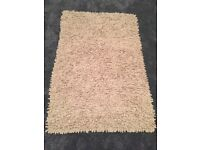 Natural rug, loop design in new condition £15