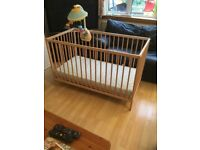 Mother care cot with babies mobile