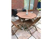 Hardwood wooden folding table and four folding chairs