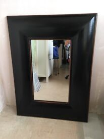 Mirror with wide black solid wood frame
