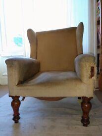 Fine Antique Wing back Armchair requiring re-upholstering. Solid wood frame