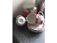 Red biscuit barrel with 4 damask porcelain cups and saucers
