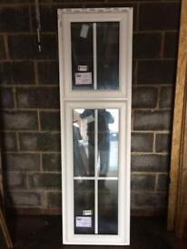 Large window with Georgian Bar glass, it's brand new, A rated, size 605 x 2095, for £100.