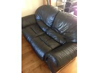 Soft black leather double sofa bed.