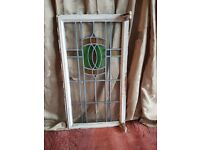 Stained glass window in metal frame