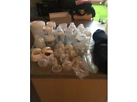 Job lot of tommee tippee bottles, microwave steriliser and bottle travel thermal holders