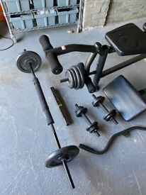 Weight lifting bench with 74.5kg of weights, 2 bars, dumbells and accessories