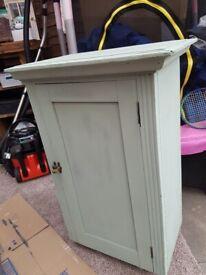 small green storage cupboard