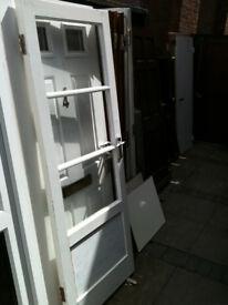 Exterior wooden door with 3 clear glass panels