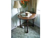 Circular Oak table with glass top